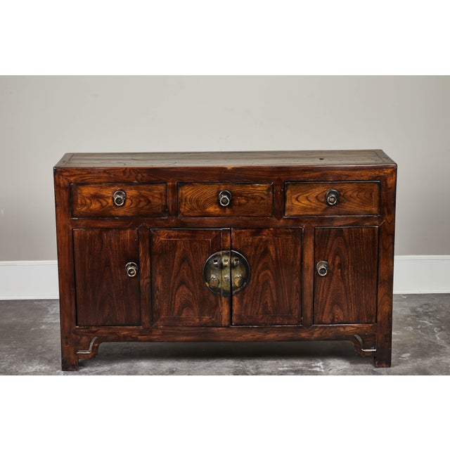 Three drawer four door side cabinet from Hebei in elm, circa 19th century.