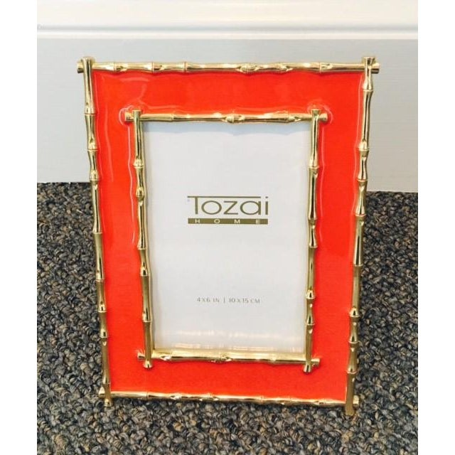 "Brynn gold bamboo border table top frame from Tozai Home. Features a bold coral color and gold accents. Holds a 4"" x 6""..."
