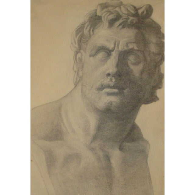 Large charcoal drawing of a sculpted marble stone bust of a classical Roman or Greek man or god figure. On fine art paper...