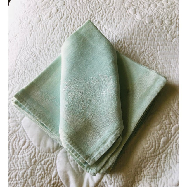 A set of eight (8) vintage mint green damask luncheon napkins in excellent condition. Dimensions are 14 by 15 inches.