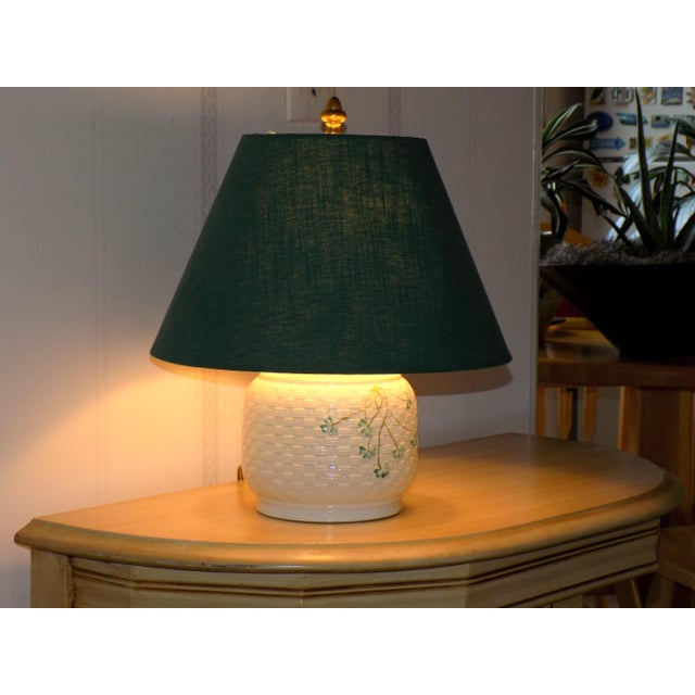 """Ireland's Belleek adds charm to your decor. A small lamp that is perfect for bedside or a hall/ foyer. About 14 """" high to..."""