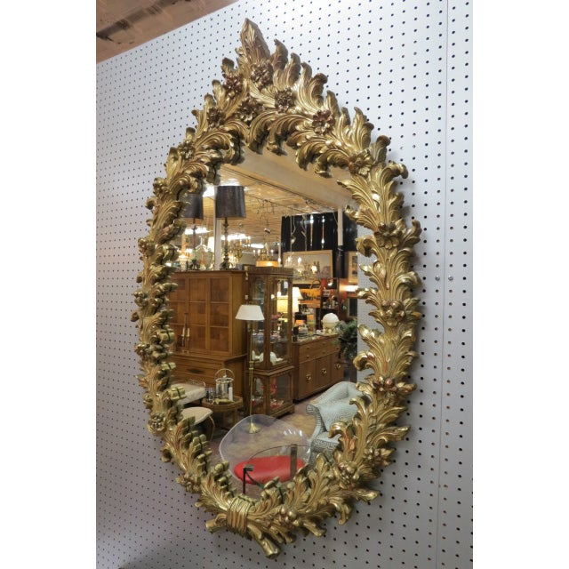 $495. Reflect on the details! Vintage Antique style Hollywood regency gilt oval mirror, c. 1960. Carved faux wood, gilt...