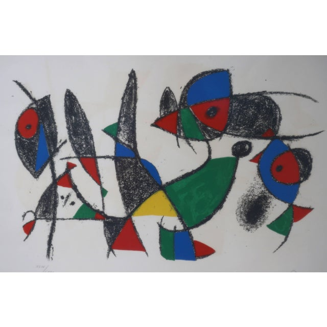 This Miro lithograph has been professionally framed with archival materials. Note: Pencil signed and numbered Note: Paper...
