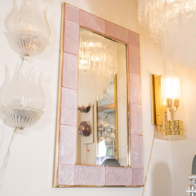 """Pink textured glass surround mirror with brass details. Origin: Italy Circa: Contemporary Dimensions: 29.5"""" wide x 1.5""""..."""