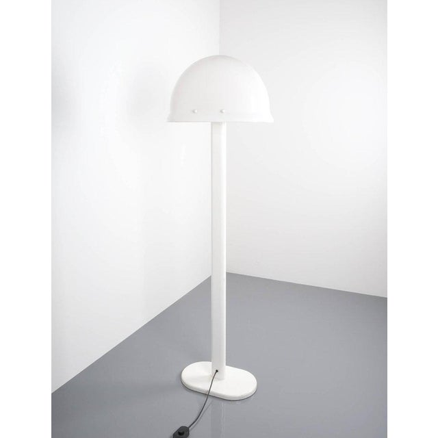 Rare graphical floor lamp by Rodolfo Bonetto, I Guzzini, Italy, 1970 featuring a helmet shaped Lucite shade on a white...