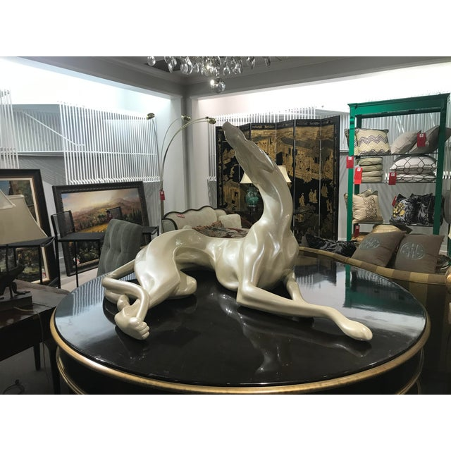 This is an over sized Display Dog from the 1970's. It is made of a resin and painted a creamy lacquer finish.
