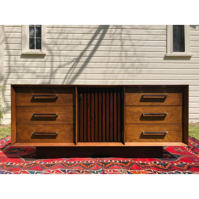 Beautiful Lane rosewood and walnut credenza from the 'Tower Collection', circa 1970s. Six pull drawers with chrome and...