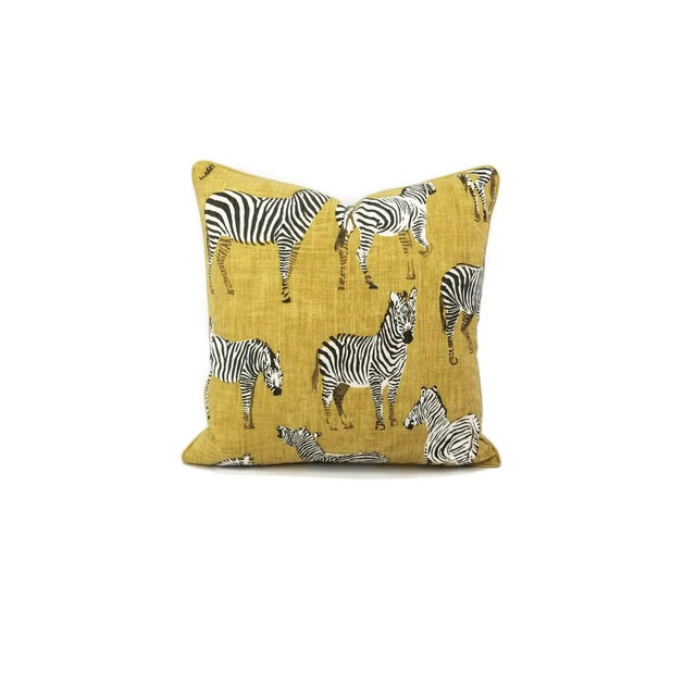 From Home Accent Fabrics with designer, Ronnie Gold is Africana in Gold cotton pillow cover. This pillow is backed with a...