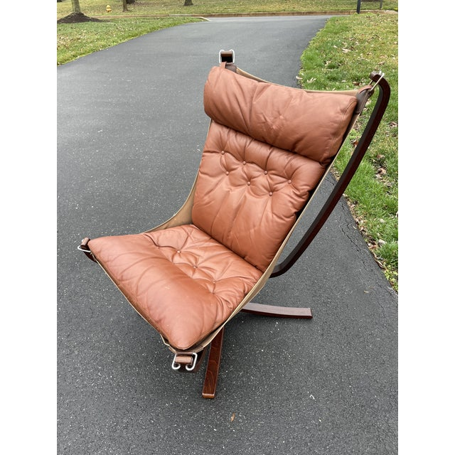 Vatne Mobler tall 'Falcon' chair in chestnut colored leather and rosewood colored veneer.