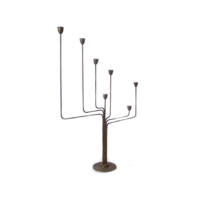 Solid brass candelabrum, created by Danish designer Piet Hein while living in Argentina. He designed this to remind him of...