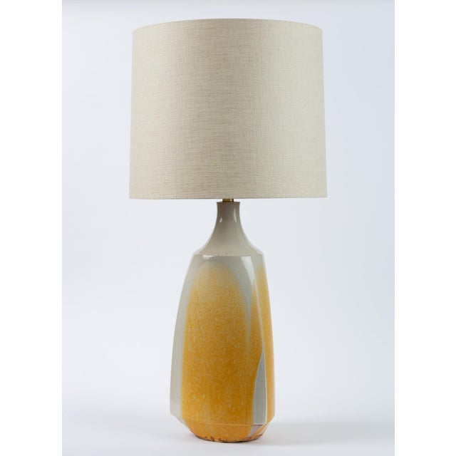 Statement lighting by David Cressey in stoneware with three sloping sides and an angular foot. The studio pottery-...