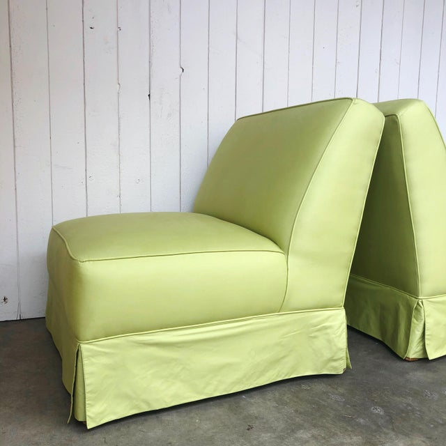 Classical silhouette skirted lounge chairs in a newly upholstered Chartreuse cotton/silk blend. Originally mid century and...