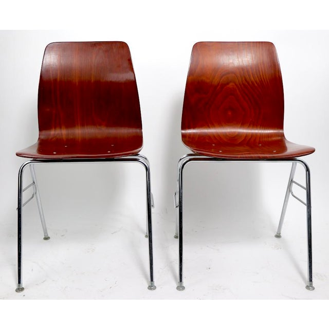Cool pair of molded plywood and chrome stacking chairs - Royal Pagholtz. Super clean, and ready to use. Offered and priced...