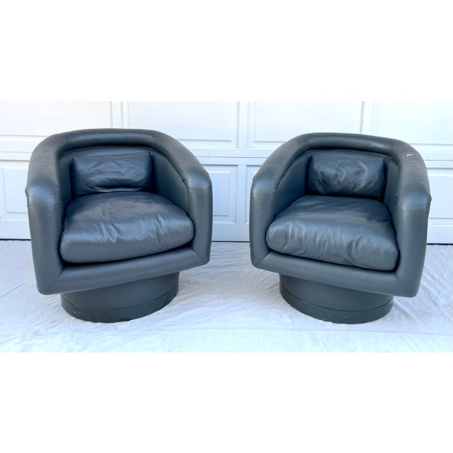 Here is a RARE pair of Postmodern swivel tub chairs that are attributed to Leon Rosen. These are currently upholstered in...