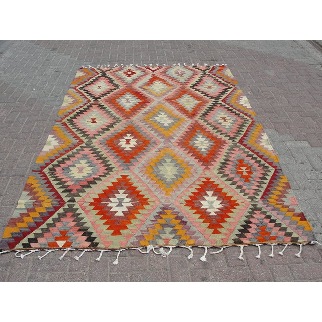 Vintage handwoven Turkish kilim rug. The kilim is nearly 55 years old. It is handmade, of very fine quality natural wool...