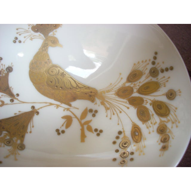 """""""Quatre Couleurs"""" from the Rosenthal Studio Line; stylized gold peacock on a free form white bowl"""