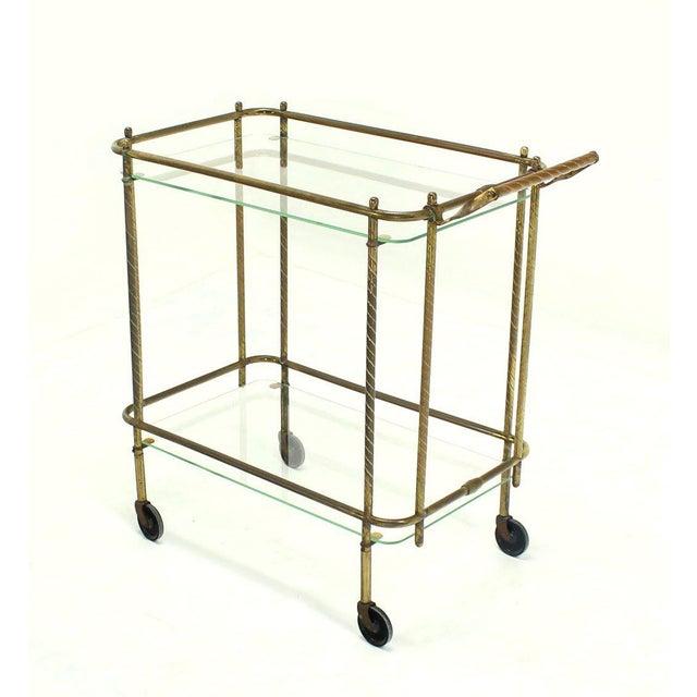 Mid Century modern brass and glass rolling tea cart.