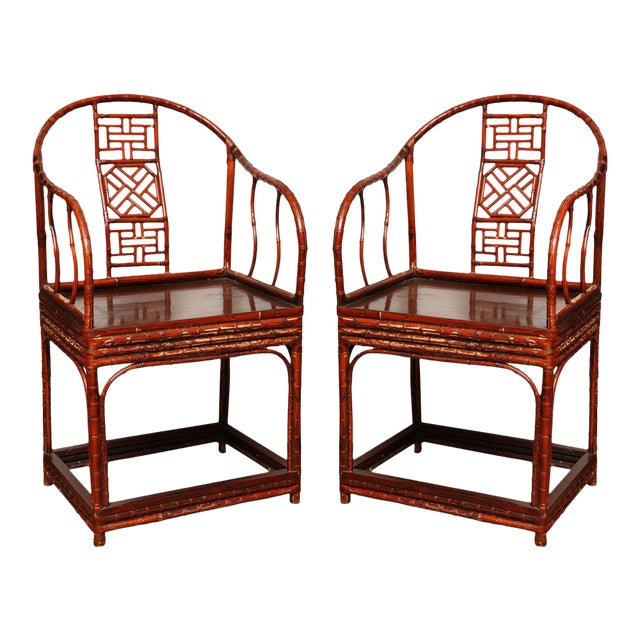 A 19th century Chinese armchair with horseshoe back and elmwood base. This Chinese horseshoe-back armchair was made in...