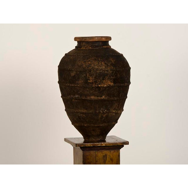 A gorgeous terra cotta urn with raised decoration from Italy c.1885. The beautiful shape of this urn with its dramatic...