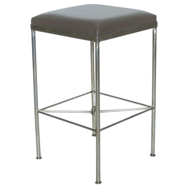 The Oliver Counter Stool is constructed of solid steel and finished in warm silver leaf. Each barstool is bench made in...