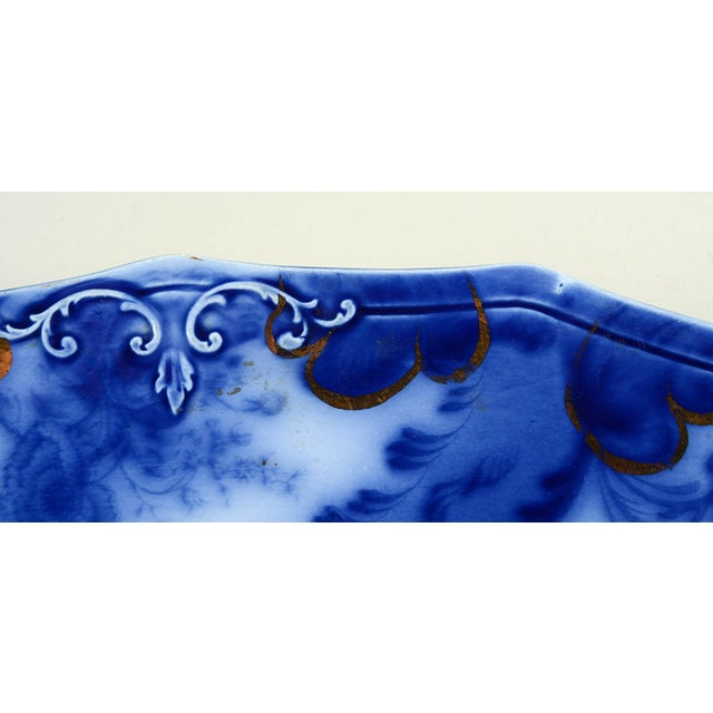 """Grindley Argyle Flow Blue 19"""" Oval Serving Platter features a rich cobalt blue floral and plume design with an embossed..."""