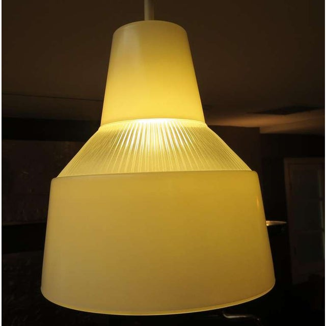 A clean and classic example of Italian Mid Century lighting. These can be used in a grouping, or in a row over a dining...