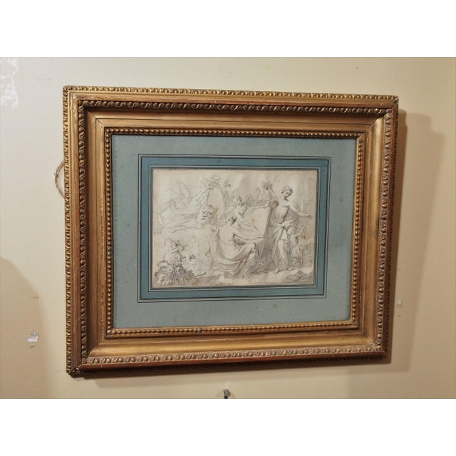 """Study in black and white on paper, blue matted and framed in an antique gilt wood frame with glass. Drawing measures 11""""..."""