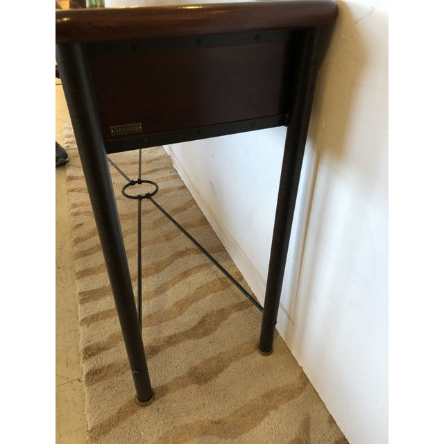 A beautiful traditional mahogany console or sofa table having handsome iron tapered legs and cross stretcher, gorgeous...