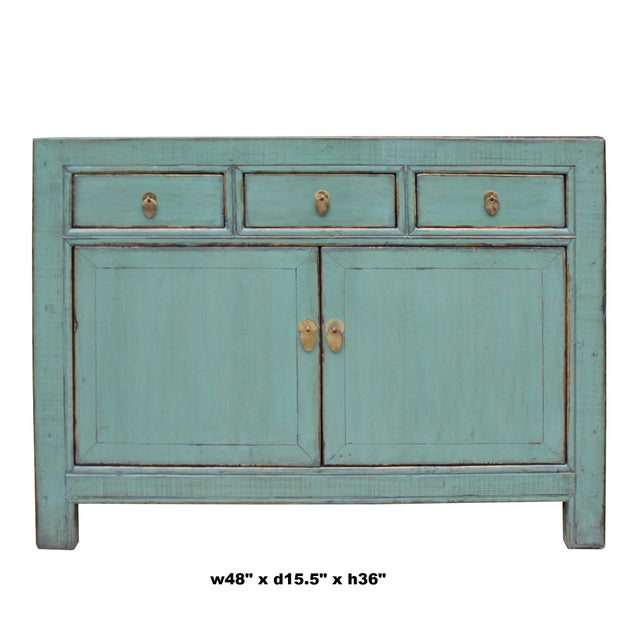 This is a sideboard credenza cabinet table with 3 drawers two doors compartments. It is finished with rustic distressed...