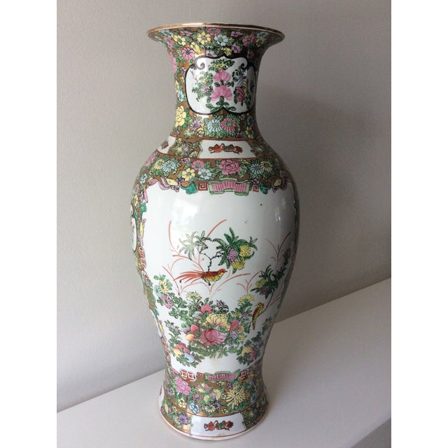 This intricate, colorful large vase was hand painted with incredible imagery; depicting a royal family watching a duel or...