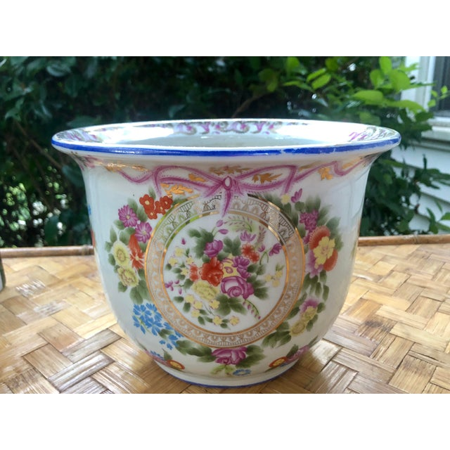 Reminiscent of Dresden, Rococo, and Sevres styles, this beautiful vintage planter is the right amount of fuss and frill!...