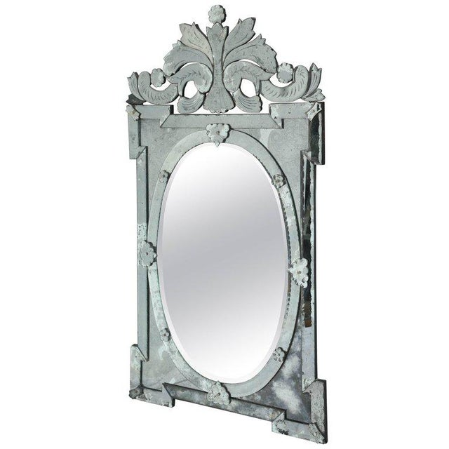 Exquisite large scale Venetian mirror with beautiful hand etched designs throughout. The mirror features a stunning oval...