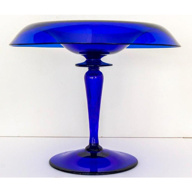 This stylish set of cobalt blue glass compotes were acquired from a Palm Beach estate and could be used on the dining...