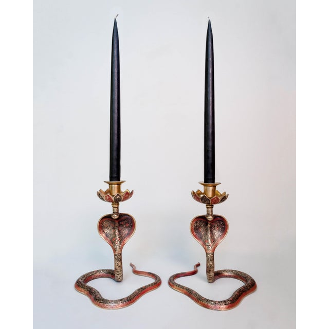 Pair of brass cobra candlesticks with beautifully etched details in red and black enamel.