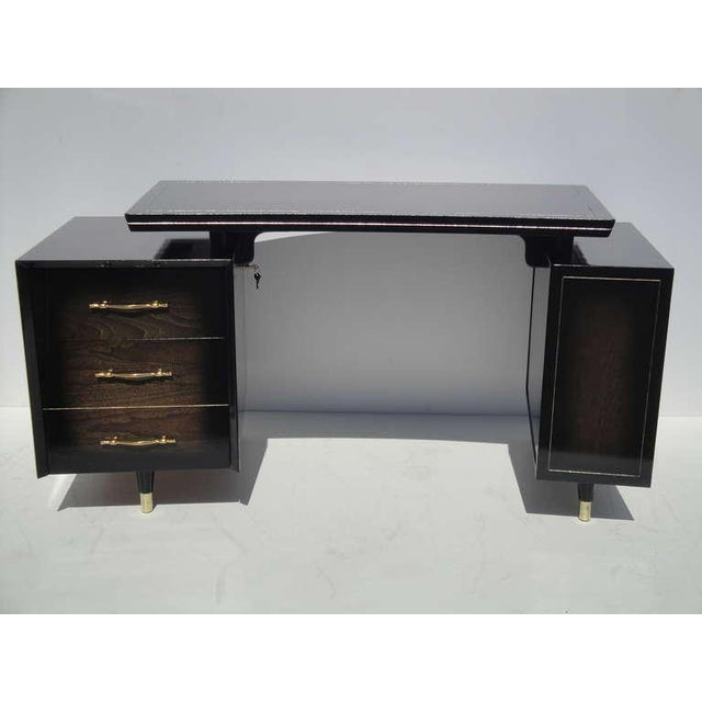 """Mid century modernist floating top curved desk in ebonized walnut with brass sabot feet. Floating top is 46"""" x 24"""""""