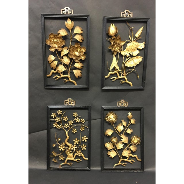 Set of Four Asian Brass Wall Hangings. Fabulous sculptural pieces with floral theme. A wonderful wall grouping that will...