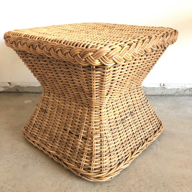 Vintage woven rattan side table with braided accents and a natural finish. Age wear, imperfections.