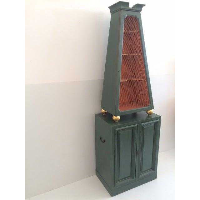 Custom made Dunbar original extremely rare Hollywood Regency Etagere cabinet. Original finish with green exterior and...