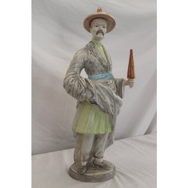 This Chinese gentleman is Handpainted and Handmade and it is a reproduction of Meissen. These Chinese figures were...