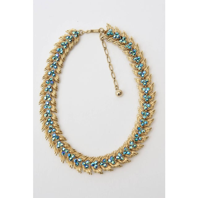 This beautifully made costume jewelry set by Trifari is mid century modern. It is a choker necklace with matching clip on...