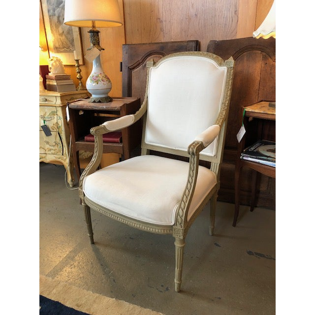 Vintage Louis XVI Style Fauteuil Chair. Carved wood frame is painted a lovely dove gray and the upholstery is relatively...