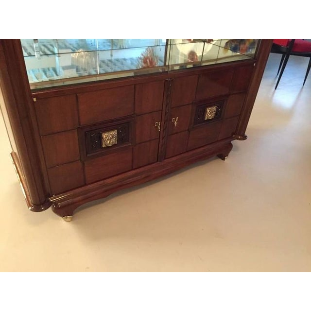 Stunning French Art Deco bronze face walnut vitrine / dry bar. This dry bar has been professionally refinished having a...