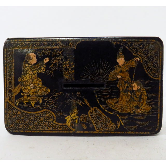 Antique chinoiserie papier mâché box from England, dated to 19th century, finished in black lacquer with gold Chinese-...