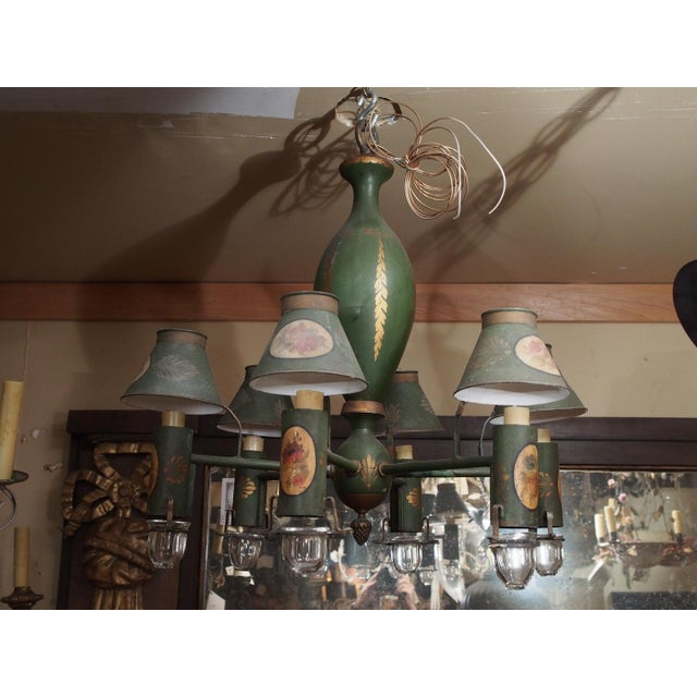6 arm French painted tole chandelier. Floral painted cartouche on each sleeve and bonnet. US wired.
