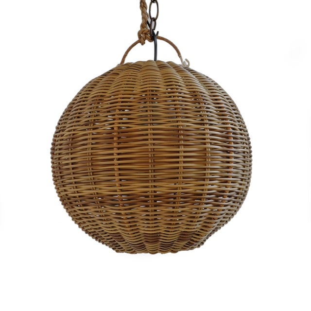 "Classic 12"" diameter faux rattan two tone globe lantern. Made to withstand exterior elements with the look of natural..."