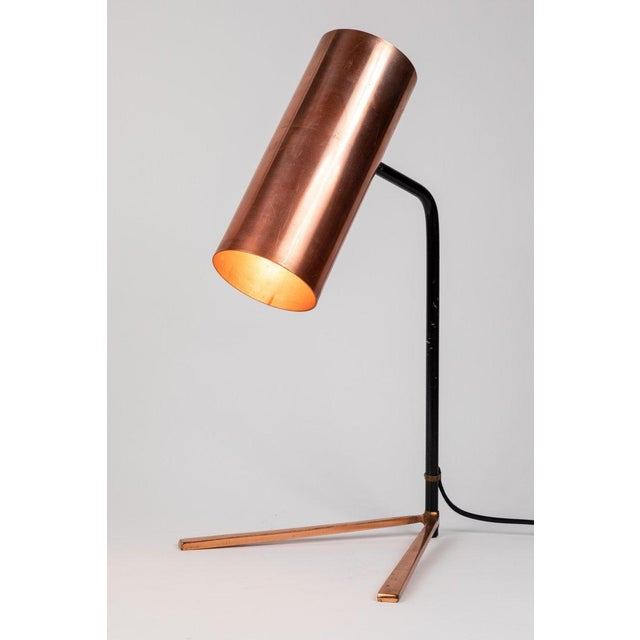1950s Stilux copper and metal table lamp. This quintessentially midcentury Italian table lamp is executed in an adjustable...
