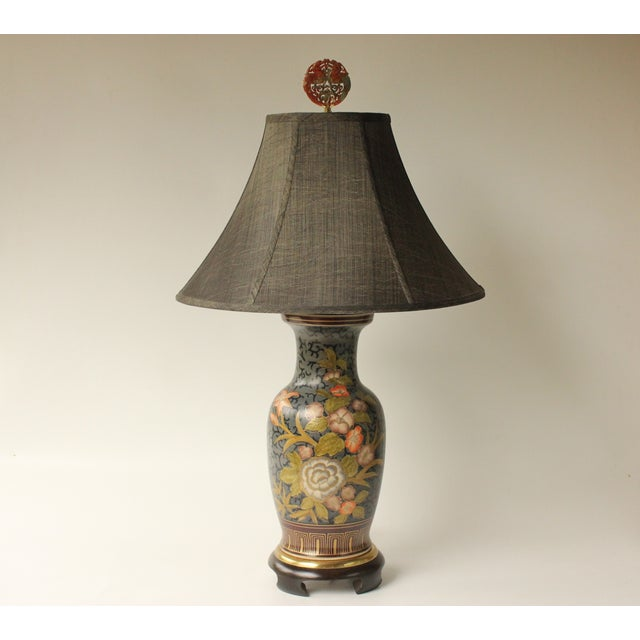"Hand-decorated porcelain table lamp with a floral motif against slate blue scrolls . It measures 31"" tall to the top of..."