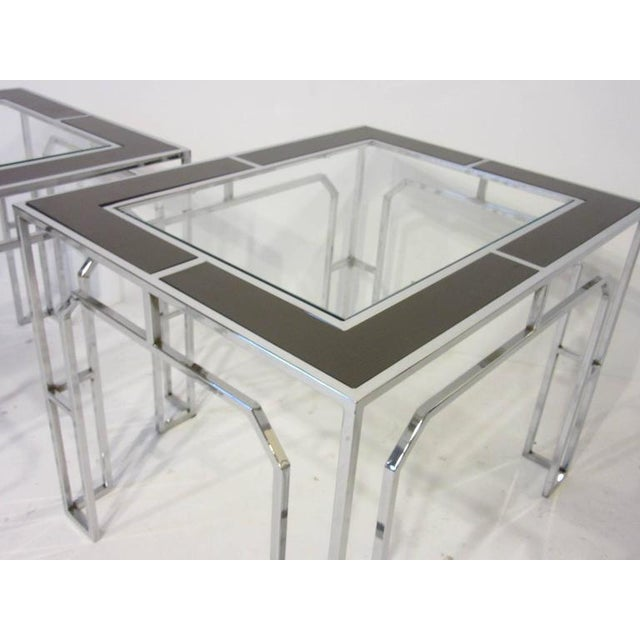 A pair of Baughman chrome framed side tables with glass and wood inserted top, the wood panels are in a warm chocolate...