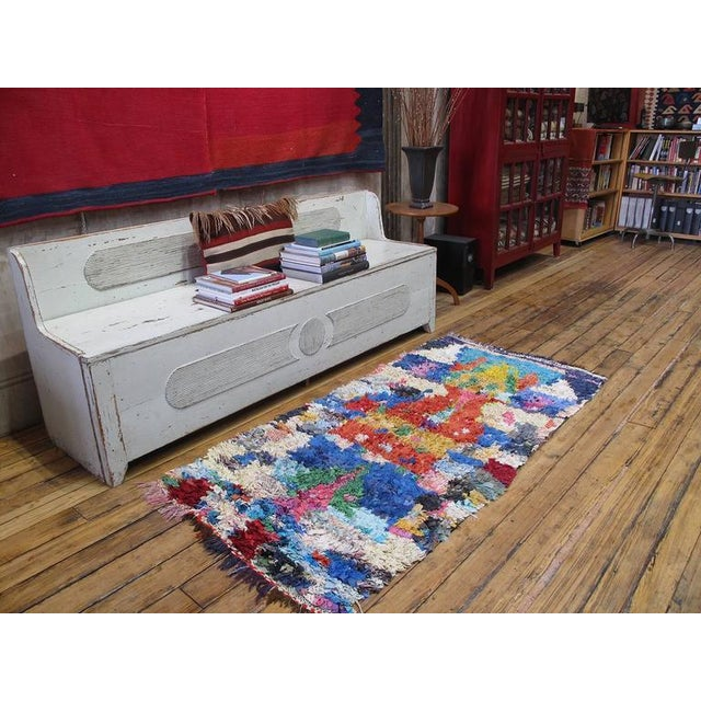 A Moroccan rag rug, woven entirely with cut-up pieces of fabric from old clothes, etc. - boucherouite means rag or torn...