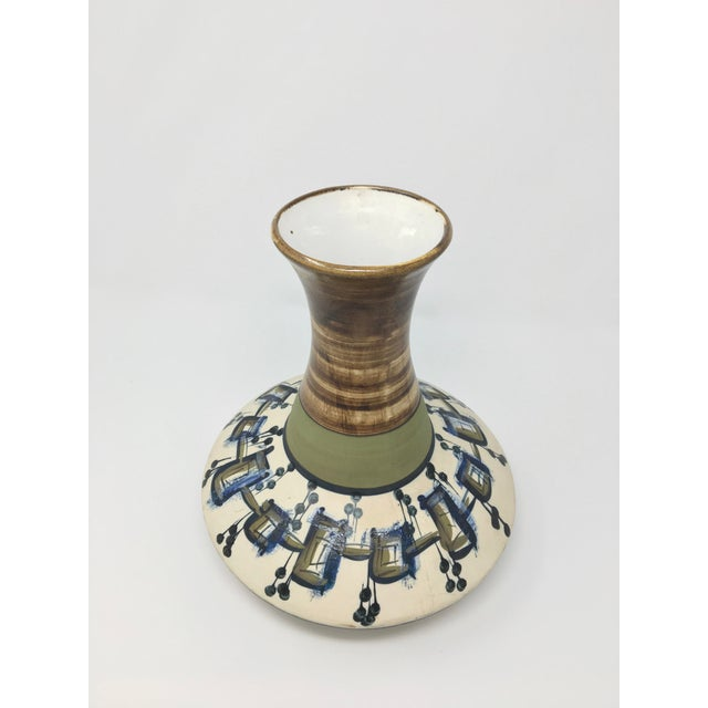 A vase from the prime era of Israeli ceramics: 1950s-60s. Potters of the period took inspiration from the local landscape...